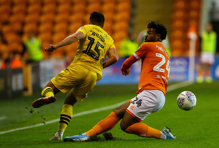Morecambe's Aaron Wildig is tackled by Blackpool's Joe Nuttall<br /> <br /> Photographer Alex Dodd/CameraSport<br /> <br /> EFL Leasing.com Trophy - Northern Section - Group G - Blackpool v Morecambe - Tuesday 3rd September 2019 - Bloomfield Road - Blackpool<br />  <br /> World Copyright © 2018 CameraSport. All rights reserved. 43 Linden Ave. Countesthorpe. Leicester. England. LE8 5PG - Tel: +44 (0) 116 277 4147 - admin@camerasport.com - www.camerasport.com