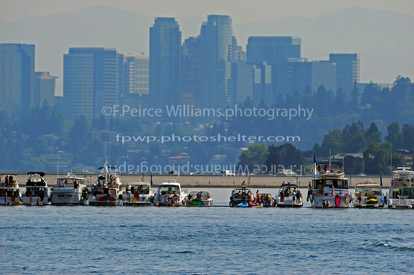 The Log Boom and the skyline of Bellvue, WA as seen from the North Turn...1-2 August, 2009 Seattle, Washington USA..©2009 F.Peirce Williams USA..