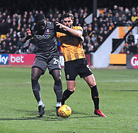 Lincoln City's John Akinde vies for possession with Cambridge United's Greg Taylor<br /> <br /> Photographer Andrew Vaughan/CameraSport<br /> <br /> The EFL Sky Bet League Two - Cambridge United v Lincoln City - Saturday 29th December 2018  - Abbey Stadium - Cambridge<br /> <br /> World Copyright © 2018 CameraSport. All rights reserved. 43 Linden Ave. Countesthorpe. Leicester. England. LE8 5PG - Tel: +44 (0) 116 277 4147 - admin@camerasport.com - www.camerasport.com