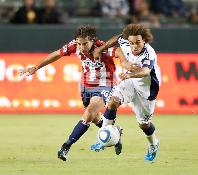 Chivas forward Alan Gordon (16) battles Revolution defender Kevin Alston (30) for the ball during the second half of the game between Chivas USA and the New England Revolution at the Home Depot Center in Carson, CA, on September 10, 2010. Chivas USA 2, New England Revolution 0.