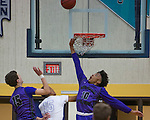 Spanish Springs Cougars Damani Craig trys for the rebound against the Reed Raiders in their basketball game played on Friday night, February 10, 2017 at Reed High School in Sparks, Nevada.