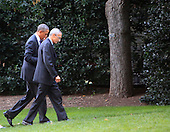 United States President Barack Obama and John Podesta, counselor to the president, walk from the motorcade to the Oval Office of the White House in Washington, D.C. on October 6, 2014.<br /> Credit: Dennis Brack / Pool via CNP