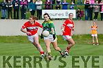 Sarah Houlihan Kerry goes past Cork's Rena Buckley and Eimear Meaney during their clash in the TG4 Munster Senior Championship in Macroom on Friday evening