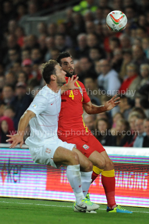 Joe Ledley of Wales and Celtic battles with Ivanovic of Serbia and Chelsea for a high ball during the Wales v Serbia FIFA World Cup 2014 Qualifier match at Cardiff City Stadium, Cardiff, Wales -Tuesday 10th Sept 2014. All images are the copyright of Jeff Thomas Photography-07837 386244-www.jaypics.photoshelter.com