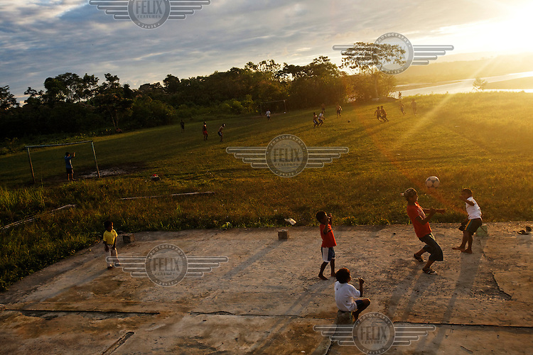 Children play football as the sun sets over the Quichua community of San Pedro Sumino, located on the Napo River.
