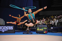 September 13, 2009; Mie, Japan;  Belarus rhythmic group performs with 5-hoops to win bronze in this group Event Final at the 2009 World Championships Mie, Japan.  Split leaping (center) in this photo is Nastasiya Ivankova. Photo by Tom Theobald.