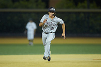 Zach Nussbaum (36) of the Davidson Wildcats hustles towards third base against the Wake Forest Demon Deacons at David F. Couch Ballpark on May 7, 2019 in  Winston-Salem, North Carolina. The Demon Deacons defeated the Wildcats 11-8. (Brian Westerholt/Four Seam Images)