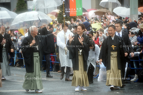 March 27, 2013, Tokyo, Japan - Nakamura Tokizo, left, and Nakamura Fukusuke wave to cheering fans as they walk with other Kabuki actors during a parade in the rain through the main street of Tokyo's Ginza shopping district on Wednesday, March 27, 2013, in celebration of the grand opening of new Kabuki theater. After three years of renovation, the majestic theater for Japan's centuries-old performing arts of Kabuki will open its doors to the public with a three-month series of most sought-after plays.  (Photo by Natsuki Sakai/AFLO)