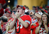 An Ohio State Buckeyes fan celebrates during the third quarter of a NCAA Division I college football game between the TCU Horned Frogs and the Ohio State Buckeyes on Saturday, September 15, 2018 at AT&T Stadium in Arlington, Texas. [Joshua A. Bickel/Dispatch]