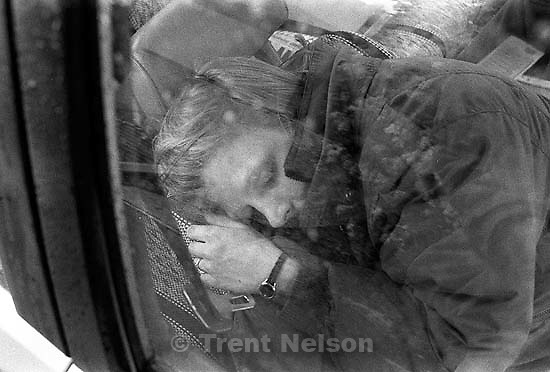 Laura Nelson sleeping in car on rainy day<br />