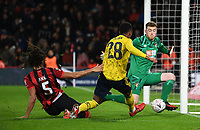 27th January 2020; Vitality Stadium, Bournemouth, Dorset, England; English FA Cup Football, Bournemouth Athletic versus Arsenal; Goalkeeper Mark Travers of Bournemouth saves the shot from Joe Willock of Arsenal who is under pressure from Nathan Ake of Bournemouth