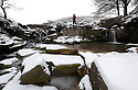 17/01/13..A walker admires the partially frozen waterfalls at Three Shires Head on Axe Edge Moor. The ancient Peak district river crossings, also known as Panniers Pool near Buxton, mark the point where Cheshire, Derbyshire and staffordshire meet and are expected to be in accessible  after forecast heavy snow tomorrow...All Rights Reserved - F Stop Press.  www.fstoppress.com. Tel: +44 (0)1335 300098.