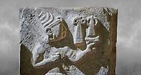 Hittite orthostat relief depicting a god. Hittie Period 1450 - 1200 BC. Hattusa Boğazkale. Çorum Archaeological Museum, Corum, Turkey. Çorum Archaeological Museum, Corum, Turkey. Against a grey bacground.