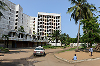 TOGO, Lome, abandoned Hotel de la Paix at Boulevard du Mono, built in 1970`íes , car of driving school / verlassenenes Hotel des Friedens