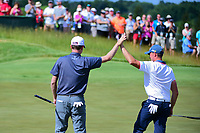 Webb Simpson (USA) high fives Tyler Light (USA) after Light's  birdie putt on 6 during Saturday's round 3 of the 117th U.S. Open, at Erin Hills, Erin, Wisconsin. 6/17/2017.<br /> Picture: Golffile | Ken Murray<br /> <br /> <br /> All photo usage must carry mandatory copyright credit (&copy; Golffile | Ken Murray)