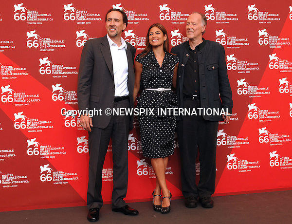 """EVA MENDES, NICOLAS CAGE AND WERNER HERZOG.Bad Lieutenant - Port of Call New Orleans, at the  66th Venice Film Festival , Venice_04/09/2009.Mandatory Credit Photo: ©NEWSPIX INTERNATIONAL..**ALL FEES PAYABLE TO: """"NEWSPIX INTERNATIONAL""""**..IMMEDIATE CONFIRMATION OF USAGE REQUIRED:.Newspix International, 31 Chinnery Hill, Bishop's Stortford, ENGLAND CM23 3PS.Tel:+441279 324672  ; Fax: +441279656877.Mobile:  07775681153.e-mail: info@newspixinternational.co.uk"""