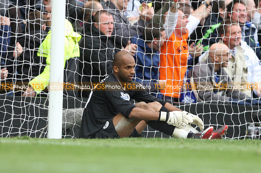 A dejected Wigan goalkeeper Ali Al Habsi after conceding a late goal - Chelsea vs Wigan Athletic - Barclays Premier League at Stamford Bridge, Chelsea - 07/04/12 - MANDATORY CREDIT: Rob Newell/TGSPHOTO - Self billing applies where appropriate - 0845 094 6026 - contact@tgsphoto.co.uk - NO UNPAID USE..