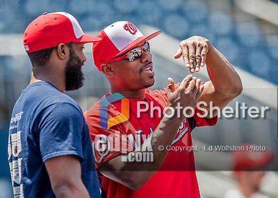 29 June 2017: Washington Nationals assistant hitting coach Jacque Jones gives advice during batting practice prior to a game against the Chicago Cubs at Nationals Park in Washington, DC. The Cubs rallied against the Nationals to win 5-4 and split their 4-game series. Mandatory Credit: Ed Wolfstein Photo *** RAW (NEF) Image File Available ***
