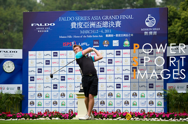 Hugo Dobson of England tees off on the 1st hole during the Round 1 of the Faldo Series Asia Grand Final at Mission Hills on March 2, 2011 in Shenzhen, China. Photo by Raf Sanchez / Faldo Series