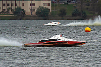 "Andrew Tate, A-25 ""Fat Chance"" races with the right sponson blown out. (2.5 MOD class hydroplane(s)"