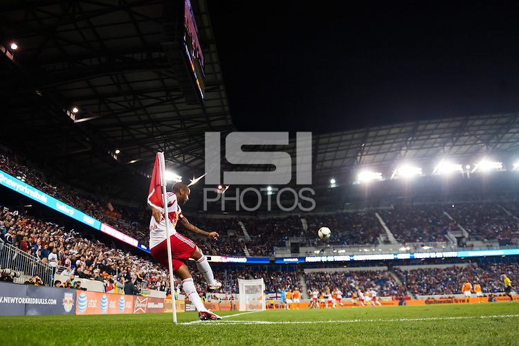 Thierry Henry (14) of the New York Red Bulls takes a corner kick. The Houston Dynamo defeated the New York Red Bulls 2-1 (4-3 on aggregate) in overtime of the second leg of the Major League Soccer (MLS) Eastern Conference Semifinals at Red Bull Arena in Harrison, NJ, on November 6, 2013.
