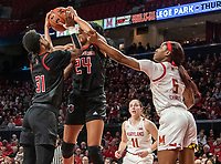 COLLEGE PARK, MD - FEBRUARY 9: Tekia Mack #31 and Arella Guirantes #24 of Rutgers take the ball from Kaila Charles #5 of Maryland during a game between Rutgers and Maryland at Xfinity Center on February 9, 2020 in College Park, Maryland.