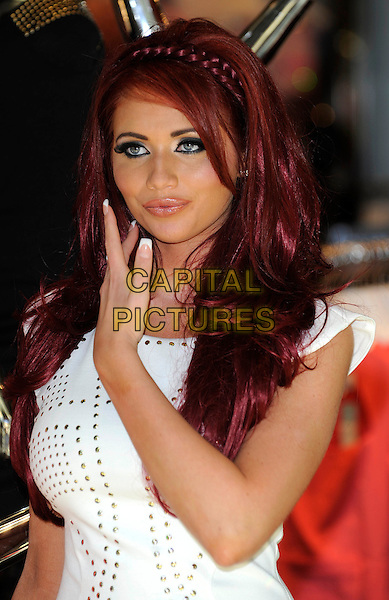 Amy Childs.Launches her new collection of clothes at Lipsy, Bluewater Shopping Centre. Kent, England, UK, May 25th 2012..portrait headshot hair make-up beauty plait braid hairband  band  white studded studs hand  .CAP/DH.©David Hitchens/Capital Pictures.