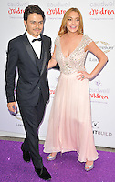 Egor Tarabasov &amp; Lindsay Lohan at the Caudwell Children Butterfly Ball, Grosvenor House Hotel, Park Lane, London, England, UK, on Wednesday 22 June 2016.<br /> CAP/CAN<br /> &copy;CAN/Capital Pictures /MediaPunch ***NORTH AND SOUTH AMERICAS ONLY***