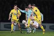 15.01.2013. Torquay, England. Exeter's Arron Davies battles with Torquay's Joe Oastler during the League Two game between Torquay United and Exeter City from Plainmoor.