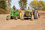 Antique tractors plowing a field in fall during the Branch 158 EDGE & TA Fall Plow Day and Plowing Seminar near Pleasant Grove, Calif...Silmer Scheidel Farm..John Deere Mod. B (C. 1947) and 820 (1957) tractors
