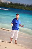 Gabriel Gaté walking along the Baie des Rouleaux beach, Isle of Pines