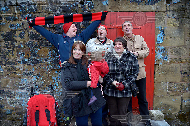 Fans (mostly friends and family of the team) of Sheffield FC arrive for a game at the BT Business Local Stadium known as the Coach and Horses Ground in Dronefield, Derbyshire. Founded in 1857, they are officially the oldest football club in the world.