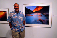 Jack Dykinga stands next to his art work on exhibit at the Tucson Museum of Art.