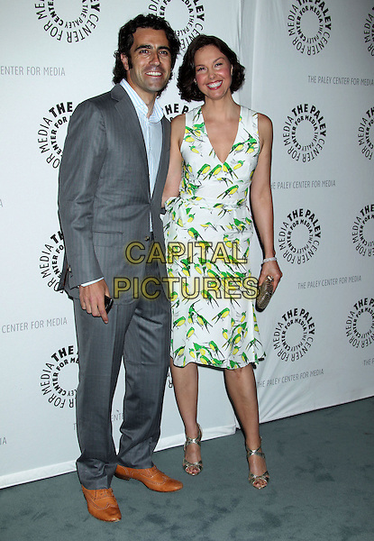 "Dario Franchitti, Ashley Judd.""Missing"" Premiere Screening presented by The Paley Center for Media held at The Paley Center For Media, Beverly Hills, California, USA..April 10th, 2012.full length white green print bird birds dress gold clutch bag grey gray profile  .CAP/ADM/RE.©Russ Elliot/AdMedia/Capital Pictures."