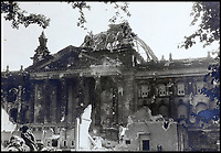 BNPS.co.uk (01202 558833)<br /> Pic:  ChiswickAuctions/BNPS<br /> <br /> The Reichstag after heavy bombardment.<br /> <br /> Remarkable previously unseen photos documenting the momentous closing stages of World War Two and its historic aftermath have come to light.<br /> <br /> They were taken by Sergeant Charles Hewitt, of the Army Film and Photographic Unit, who later went on to work for the Picture Post and the BBC.<br /> <br /> He was present at many of the important offensives of 1944 and '45 including the Battle of Monte Cassino during the Italian Campaign and the Allies advance into Germany following the D-Day invasion.