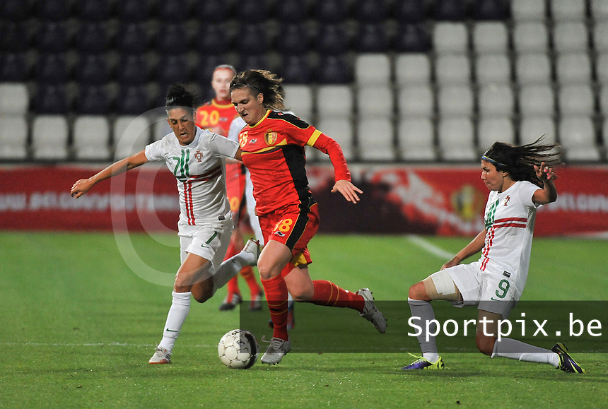 20131031 - ANTWERPEN , BELGIUM : Belgian Maud Coutereels (18) pictured in between Portugese Ana Borges (9) and Portugese Claudia Neto (7) during the female soccer match between Belgium and Portugal , on the fourth matchday in group 5 of the UEFA qualifying round to the FIFA Women World Cup in Canada 2015 at Het Kiel stadium , Antwerp . Thursday 31st October 2013. PHOTO DAVID CATRY