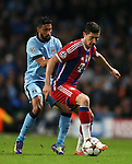 Robert Lewandowski of Bayern Munich holds off Gael Clichy of Manchester City - UEFA Champions League group E - Manchester City vs Bayern Munich - Etihad Stadium - Manchester - England - 25rd November 2014  - Picture Simon Bellis/Sportimage