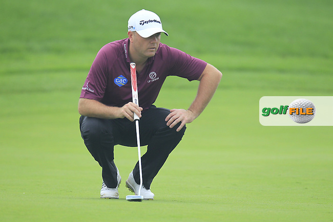 Graeme Storm (ENG) on the 5th green during Saturay's Round 3 of the 2014 BMW Masters held at Lake Malaren, Shanghai, China. 1st November 2014.<br /> Picture: Eoin Clarke www.golffile.ie