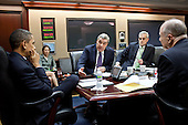 United States President Barack Obama is briefed by Lieutenant General Doug Lute, Special Assistant to the President for Afghanistan and Pakistan, during a meeting in the Situation Room of the White House, March 2, 2011. Deputy National Security Advisor Denis McDonough and National Security Advisor Tom Donilon are at right. .Mandatory Credit: Pete Souza - White House via CNP