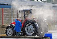 Pressure washing a tractor, Carlisle Livestock Market.......John Eveson, Dinkling Green Farm, Whitewell, Clitheroe, Lancashire. BB7 3BN.01995 61280. 07973 482705.j.r.eveson@btinternet.com.www.johneveson.com