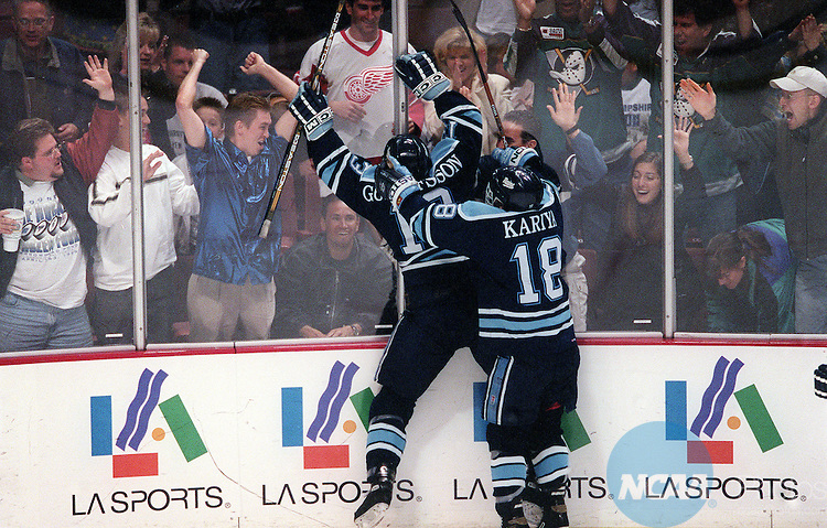 3 APR 1999:  University of Maine's Marcus Gustafsson celebrates his team's victory with the crowd following the end of the Division I Men's Hockey Championship held at Arrowhead Pond in Anaheim, CA. Maine defeated New Hampshire 3-2 in overtime for the championship title. Tom Mendoza/NCAA Photos.