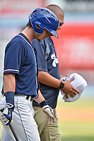 Asheville Tourists designated hitter Brendan Rodgers (1) leaves the field with trainer Casey Papas during a game against the West Virginia Power at McCormick Field on June 25, 2016 in Asheville, North Carolina. The Tourists defeated the Power 8-4. (Tony Farlow/Four Seam Images)