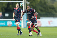 Tjiuee Uanivi of London Scottish chases the ball during the Greene King IPA Championship match between London Scottish Football Club and Hartpury RFC at Richmond Athletic Ground, Richmond, United Kingdom on 28 October 2017. Photo by David Horn.