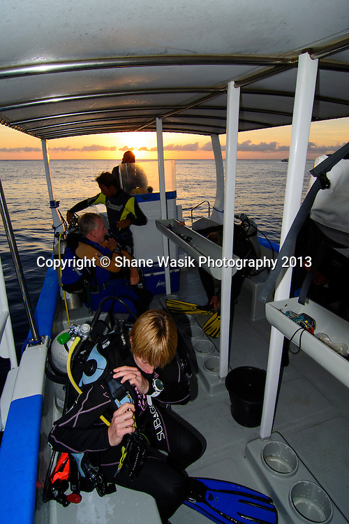 Gearing up for a dawn dive on the Liberty