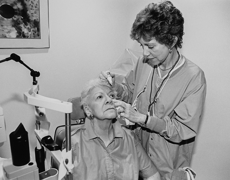 Doctor putting eye drops into the eye of women in July 1997. (Photo by Rebecca Roth/CQ Roll Call via Getty Images)