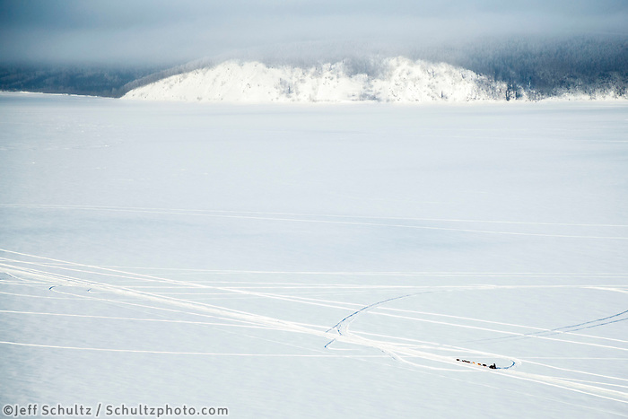 Sebastien Vergnaud on the Yukon River 5 miles before the Kaltag checkpoint during the 2017 Iditarod on Sunday afternoon March 12, 2017.<br /> <br /> Photo by Jeff Schultz/SchultzPhoto.com  (C) 2017  ALL RIGHTS RESERVED
