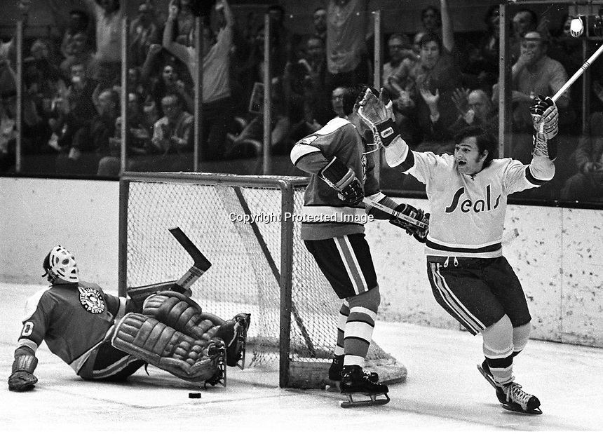 Seals Tom Webster scores against the Penguins goalie .Les Binkley  #4 Dave Burrows..(1971 photo by Ron Riesterer)