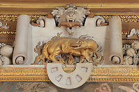 "Golden salamander in the flames, symbol of Francois I, his ""nustrisco et extinguo"", in carved stucco from the frame of the Sacrifice fresco by Rosso Fiorentino, 1535-37, in the Galerie Francois I, begun 1528, the first great gallery in France and the origination of the Renaissance style in France, Chateau de Fontainebleau, France. The Palace of Fontainebleau is one of the largest French royal palaces and was begun in the early 16th century for Francois I. It was listed as a UNESCO World Heritage Site in 1981. Picture by Manuel Cohen"