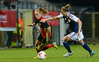 20170411 - LEUVEN ,  BELGIUM : Belgian Janice Cayman  pictured in a duel with Scottish Nicola Docherty (r) during the friendly female soccer game between the Belgian Red Flames and Scotland , a friendly game in the preparation for the European Championship in The Netherlands 2017  , Tuesday 11 th April 2017 at Stadion Den Dreef  in Leuven , Belgium. PHOTO SPORTPIX.BE | DAVID CATRY