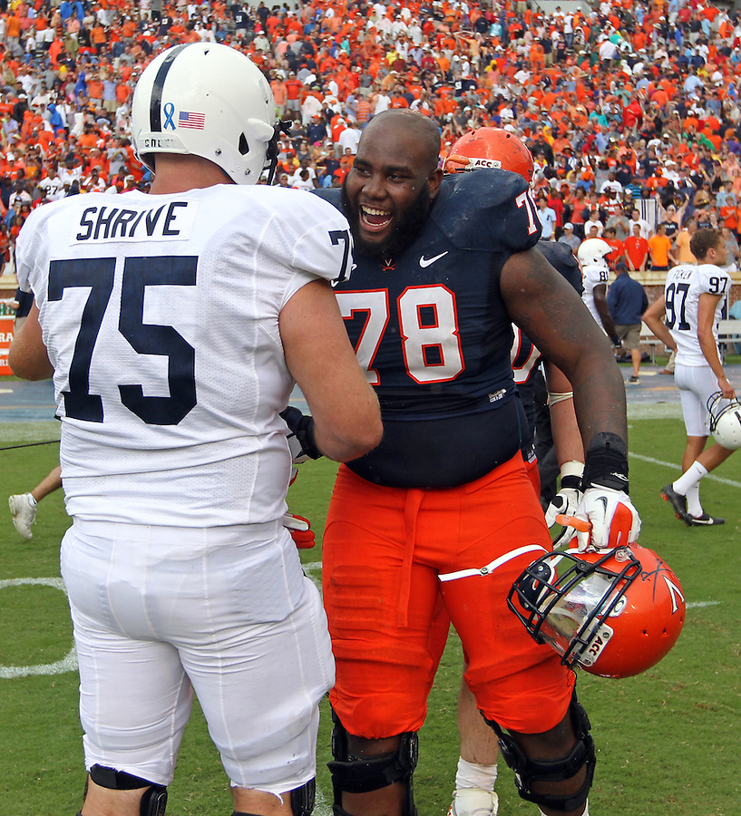 Virginia offensive tackle Morgan Moses (78) greets Penn State guard Eric Shrive (75) during an NCAA college football game in Charlottesville, Va. Virginia defeated Penn State 17-16.